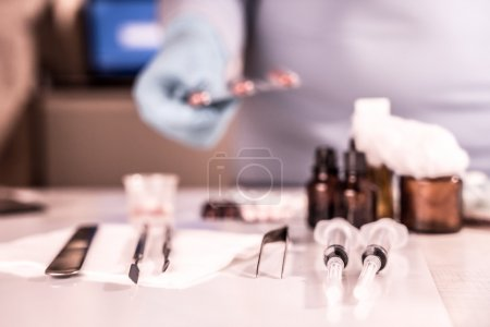 Syringe with glass vials and medications pills drug