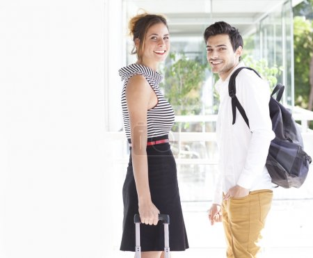 Young gorgeous couple with luggage