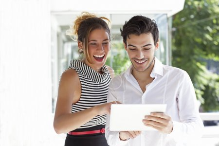 Young gorgeous couple with tablet computer