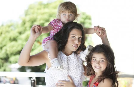 Photo for Portrait of mother and two young cute daughters - Royalty Free Image