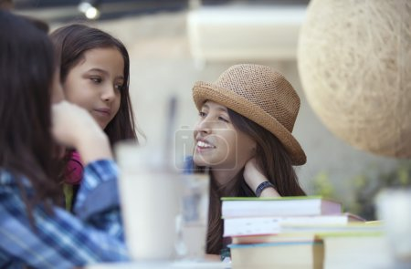 student  straw hat with schoolmates