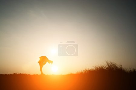 Silhouette of woman tired from walking travel