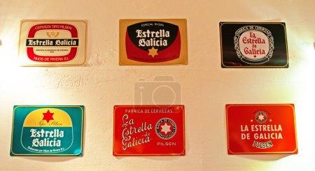 Menorca, Balearic islands, Spain: the various logos of Estrella Galicia in a pub in Mahon