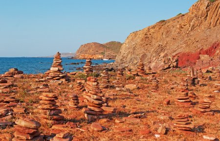 Menorca, Balearic Islands, Spain: rock castles and red sand on the path to Cala Pregonda beach