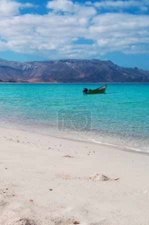 A boat in Shauab beach, mountains, sands, western cape, Socotra, Yemen