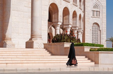 A veiled yemeni woman walking on the stairs of the Saleh Mosque, friezes and decorations, Sana'a, new building, place of worship and prayer, minaret, the crescent, columns, Yemen