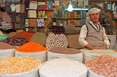 A yemeni man in the salt market of the Old City of Sana'a, suq, Yemen, seller, spices, saffron, daily life