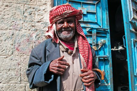 A yemeni old man smiles in the jewish quarter of the Old City of Sana'a, turban, Yemen