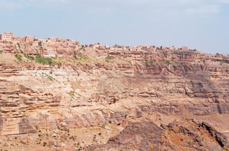 Red rocks and decorated old houses, Kawkaban, the ancient walls, Yemen