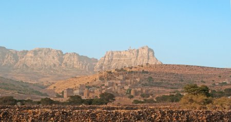 Fortified city, ancient walls, mountains, Yemen