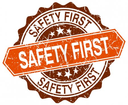 safety first orange round grunge stamp on white