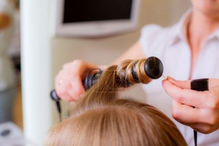 hairdresser doing curls