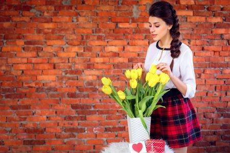 Girl with yellow tulips