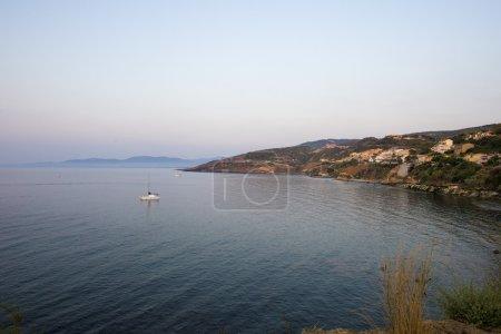 Sardinia coast with ship in sea
