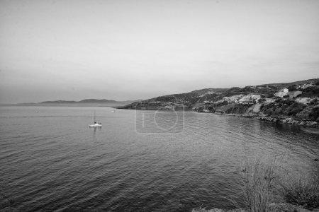 Sardinia coast with ship in coast