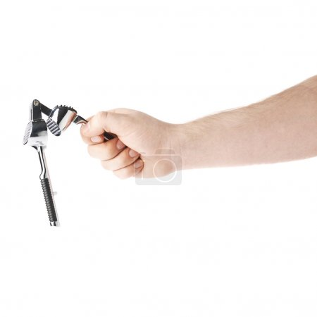 Hand holding a garlic masher, composition isolated over the white background