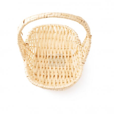 Brown wicker basket isolated over the white background