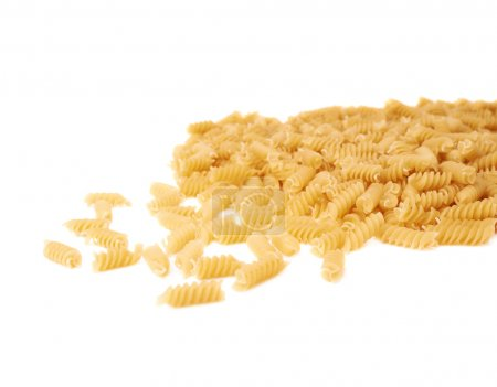 Photo for Pile of dry rotini yellow pasta over isolated white background - Royalty Free Image