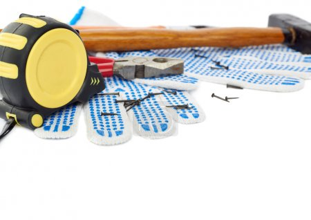 Pile of working tools over isolated white background