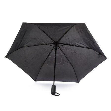 Black umbrella isolated over the white background