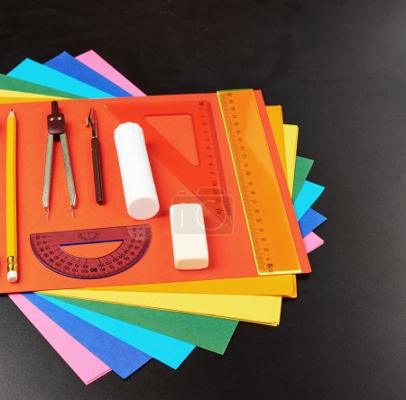 Stationery over the colorful sheets
