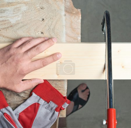 Sawing wooden board