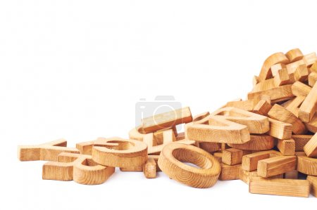 Pile of wooden block letters isolated over the whi...