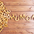 Word humor made with block wooden letters next to ...