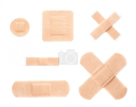 Photo for Set of multiple different adhesive bandage sticking plaster compositions isolated over the white background - Royalty Free Image