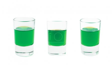 Photo for Small glasses shot filled with the green colored liqueur alcohol drink, isolated over the white background, set of three different foreshortenings - Royalty Free Image