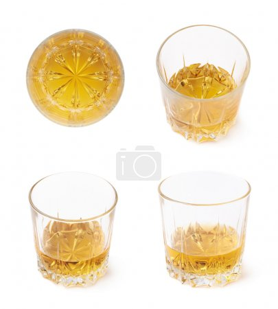 Glass tumblers filled with whiskey