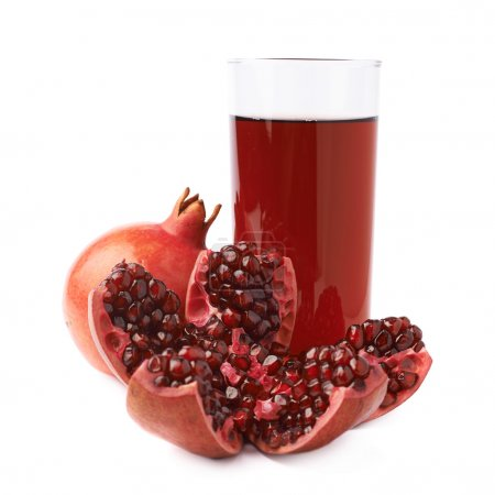 Pomegranate fruit next to the glass