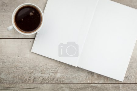 Photo for Photo blank. Open book, brochure on a wooden table and coffee - Royalty Free Image