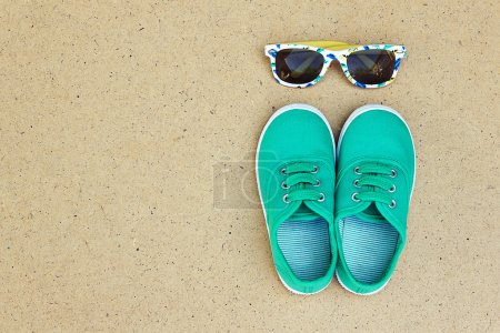 Green sneakers and sunglasses