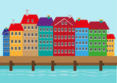 Row of tall colorful houses along a seaside view