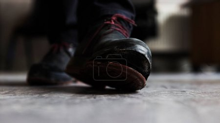 Photo for Open sole of a leather boot in front shot image on screed concrete floor. - Royalty Free Image