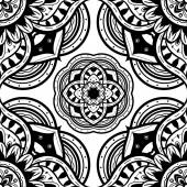 Seamless ornate pattern of the mandalas on a white background Vector ornament with round decorative elements Template for shawls carpets textiles wallpaper