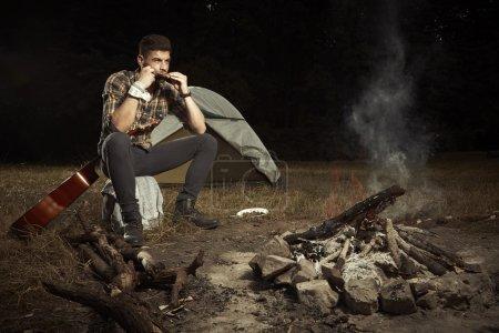 Man enjoying summer days in camp