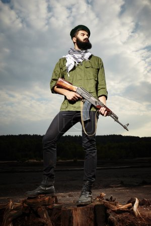 Fighter with handgun