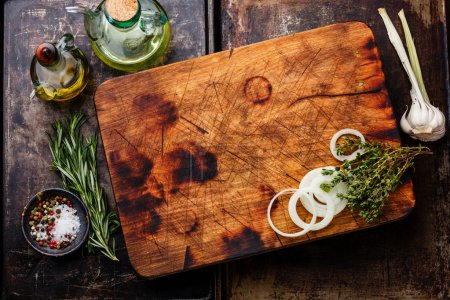 cutting board, salt, pepper and rosemary