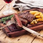 Medium rare grilled Beef steak Ribeye with roasted...