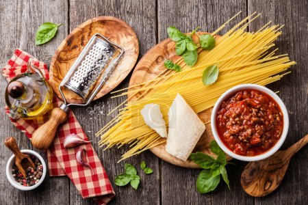 Photo for Ingredients for spaghetti bolognese on gray wooden background - Royalty Free Image