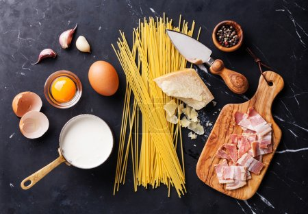 Photo for Ingredients for Pasta Carbonara on dark marble background - Royalty Free Image