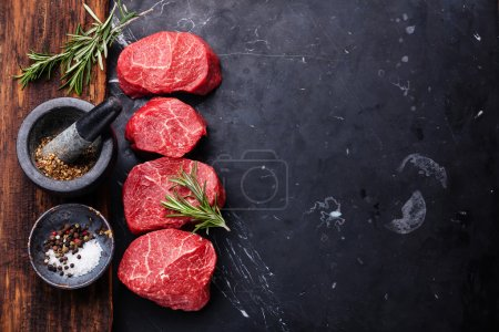 Photo for Raw fresh marbled meat Steak and seasonings on dark marble background - Royalty Free Image