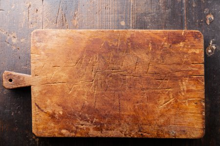 Photo for Chopping cutting board on wooden texture background, top view - Royalty Free Image