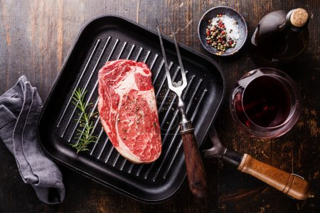 Steak with rosemary and pepper on grill pan