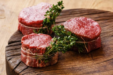 Raw fresh marbled meat Steak filet mignon and thym...