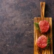 Raw fresh marbled meat Steak filet mignon on black...