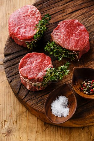 Photo for Raw fresh marbled meat Steak filets mignon and seasonings on wooden background - Royalty Free Image