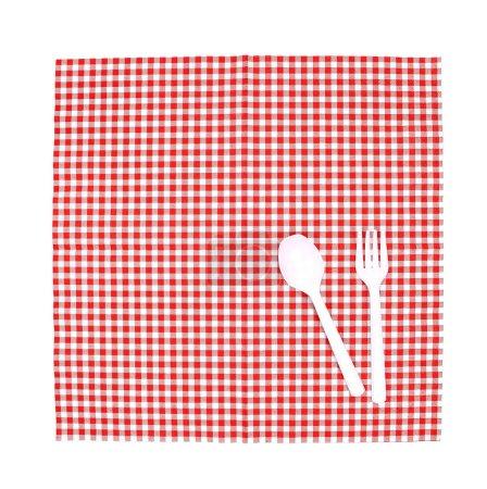 Gabel und Löffel auf Tischdecke von oben für Hintergrund zum Servieren von Speisen